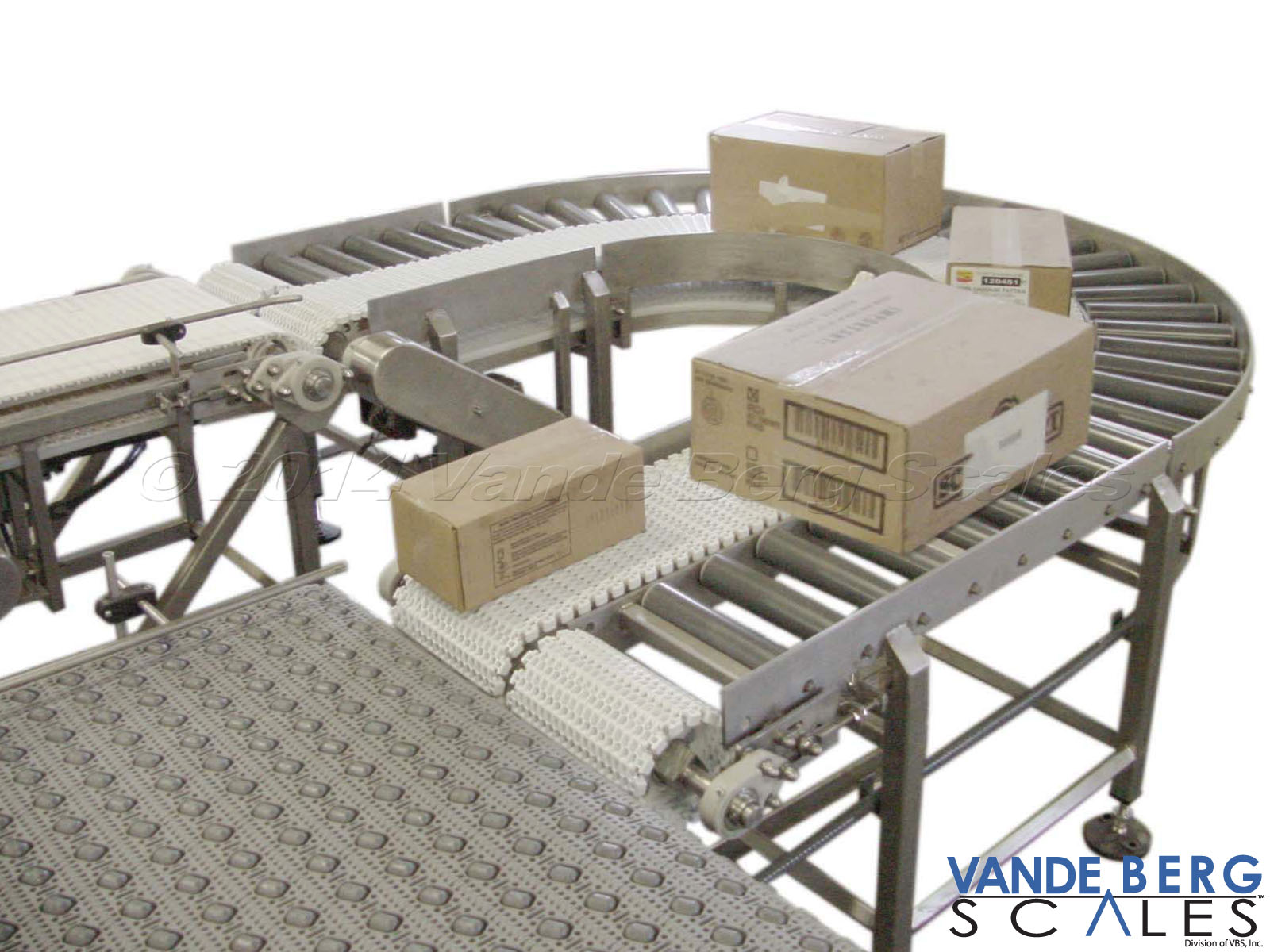 Radius Conveyor with side rails and outer non-powered rollers for tightly turning and accumulating corrugated boxes without reorientation problems in a very compact area.