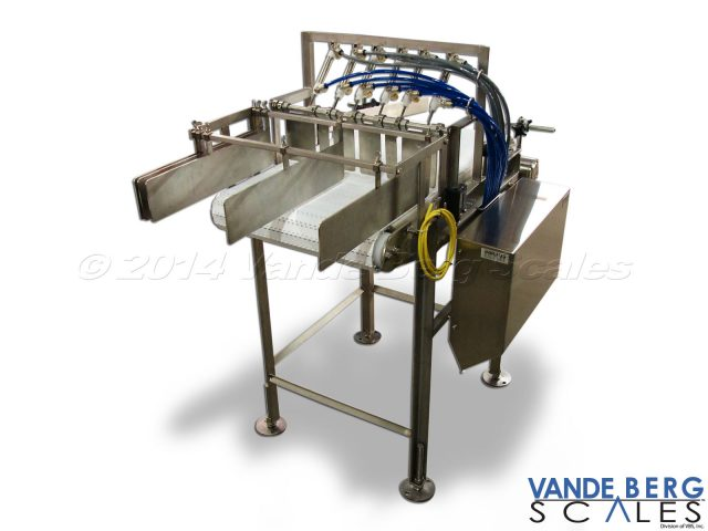 Small Package Indexing Conveyor with Merging Rails - Small packages are indexed by metal gates.