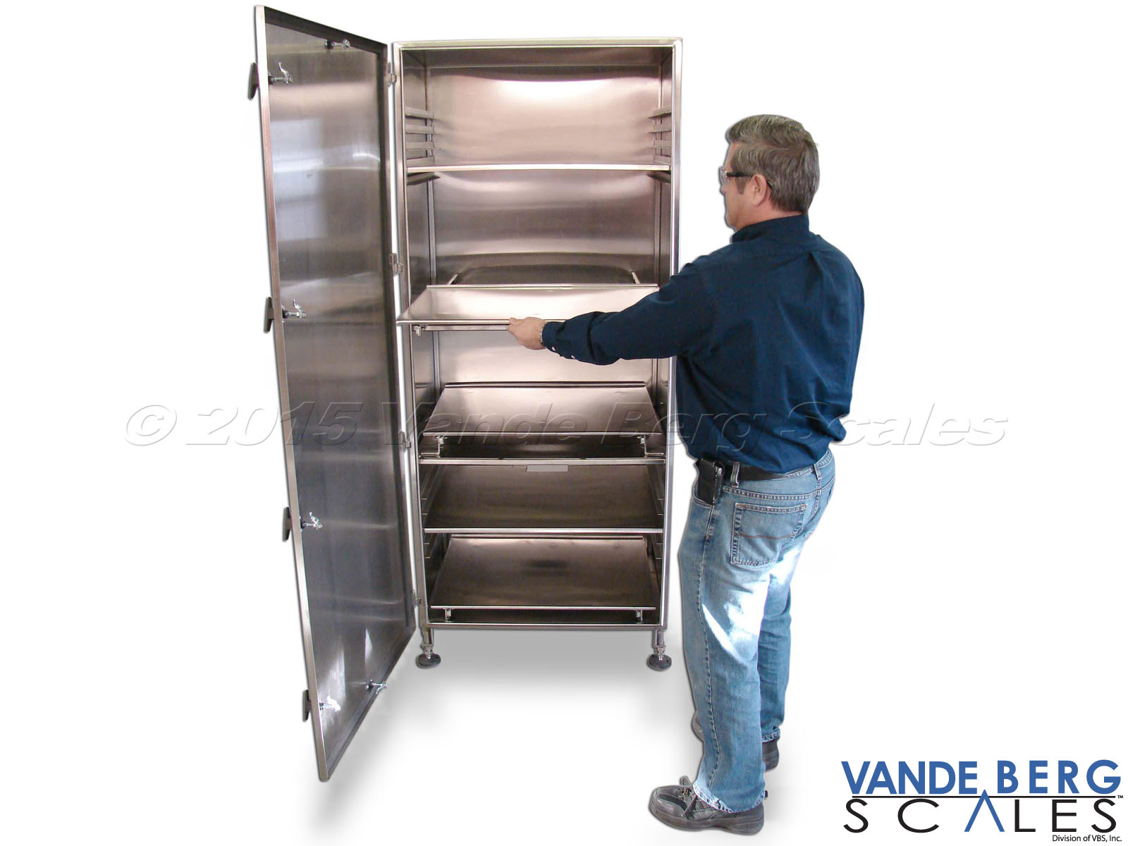 Tall stainless steel cabinet with slide-out shelves for easy component and cable access.