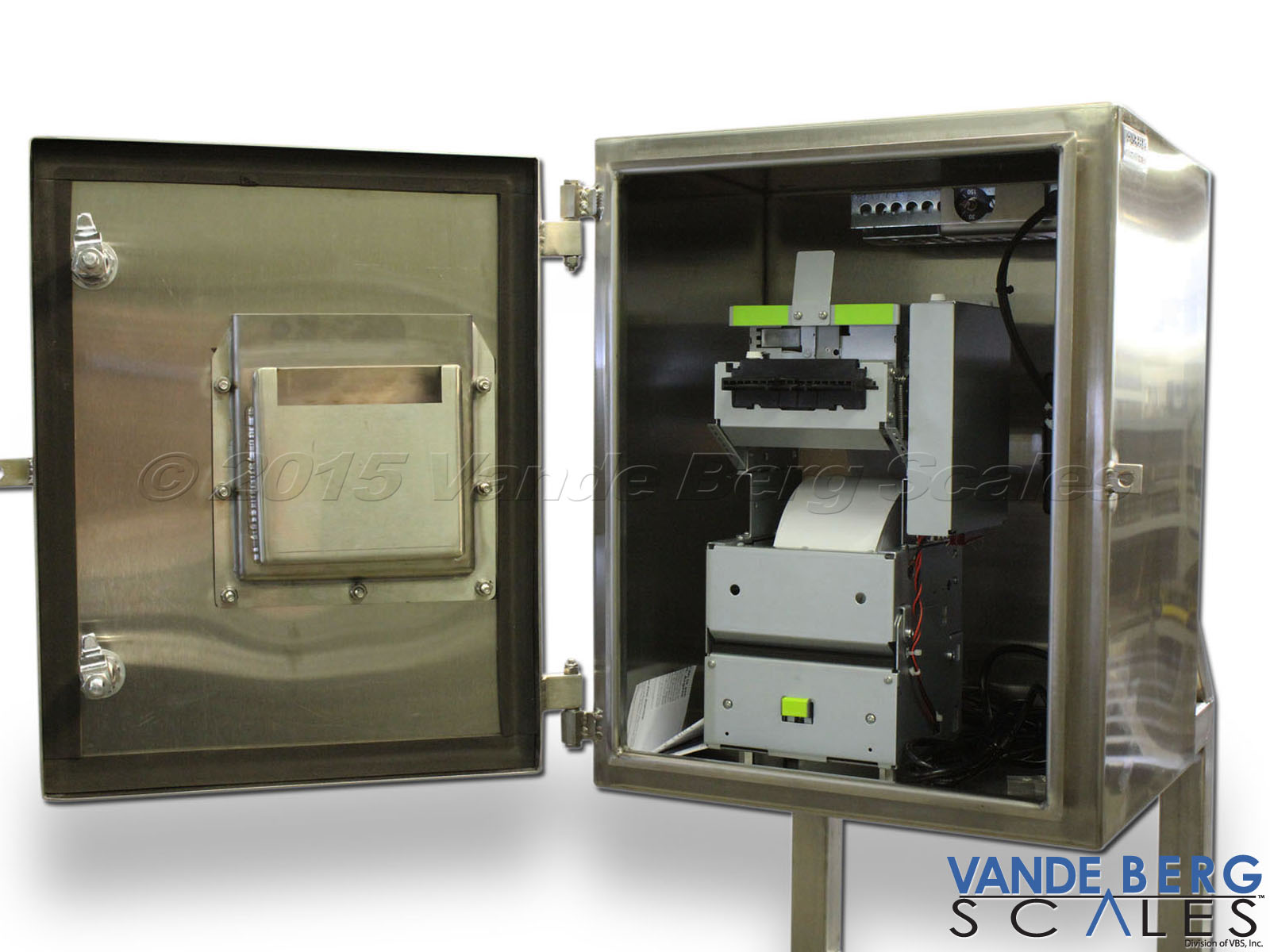 Label roll stock printer inside watertight NEMA-4X enclosure. Notice the strategically-aligned label dispensing mechanism with the door mounted receptacle.