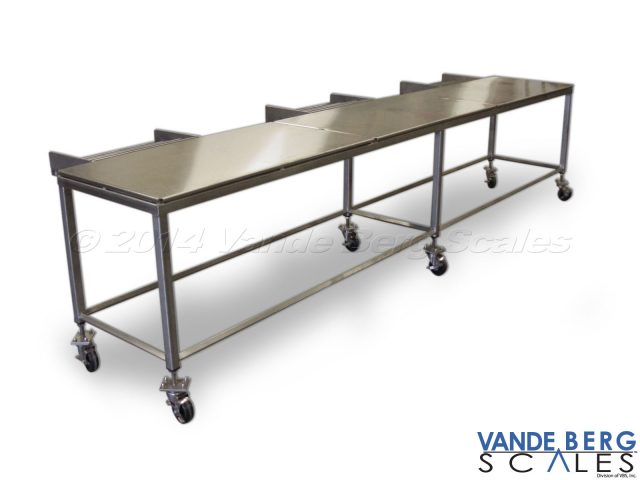 Heavy-duty stainless steel cart/table. Lockable casters permit quick change from stationary to mobile use.