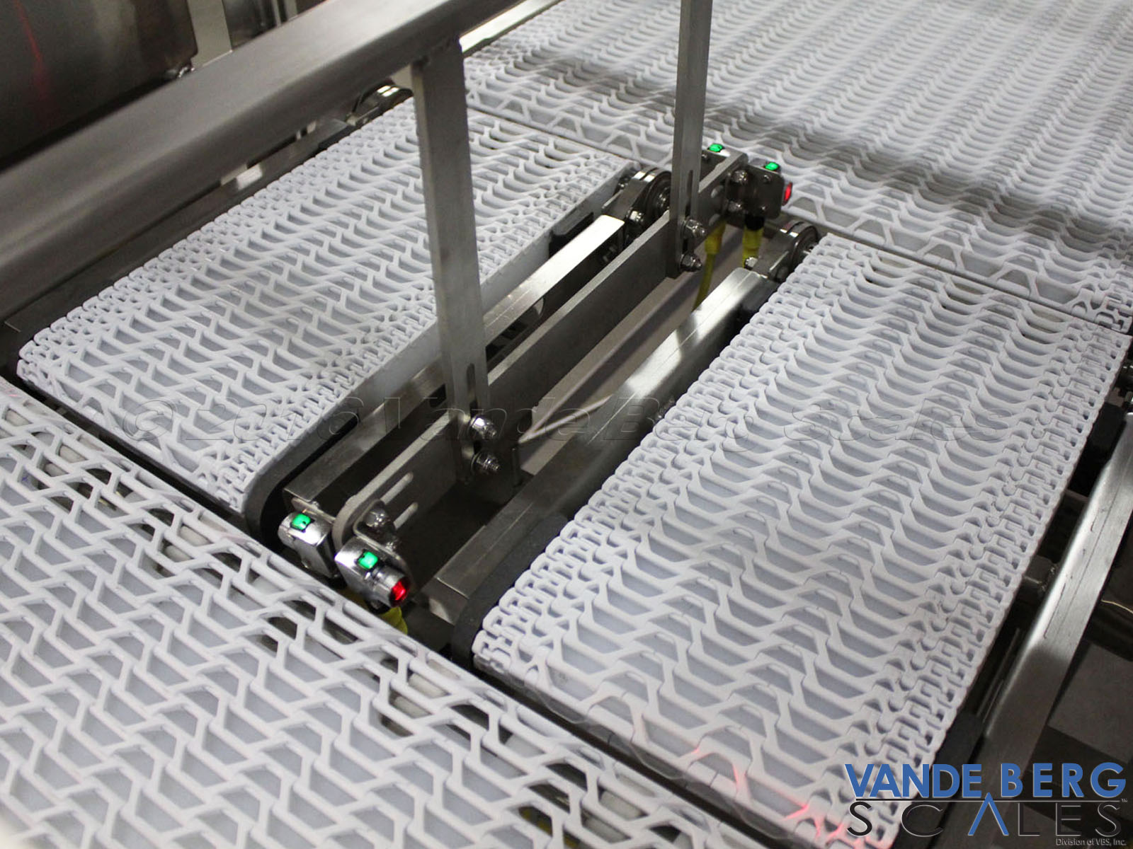 Two conveyor scales weigh product from each lane and send information to a database.