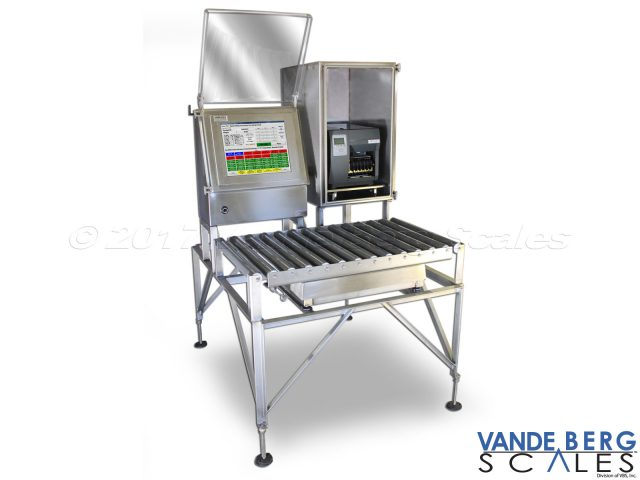 Manual Box labeler with slide out printer, scale indicator, 17-in touchscreen HMI and roller top scale.