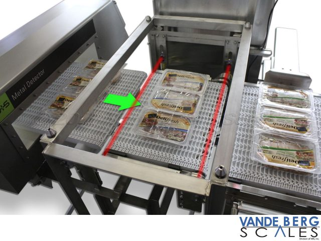 A checkweigher often follows a metal detector ensuring packages are proper weight.  Phototeyes detect the leading and trailing package edge to begin the weighment cycle.