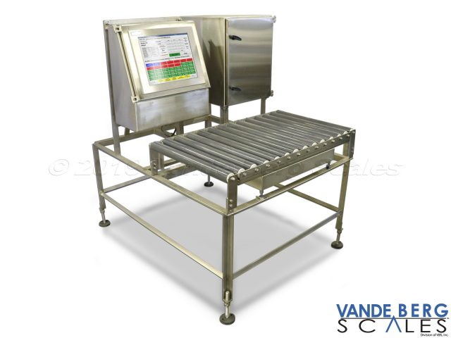 Manual box labeler with roller top scale allows the user to slide heavy boxes onto and off of the scale portion.